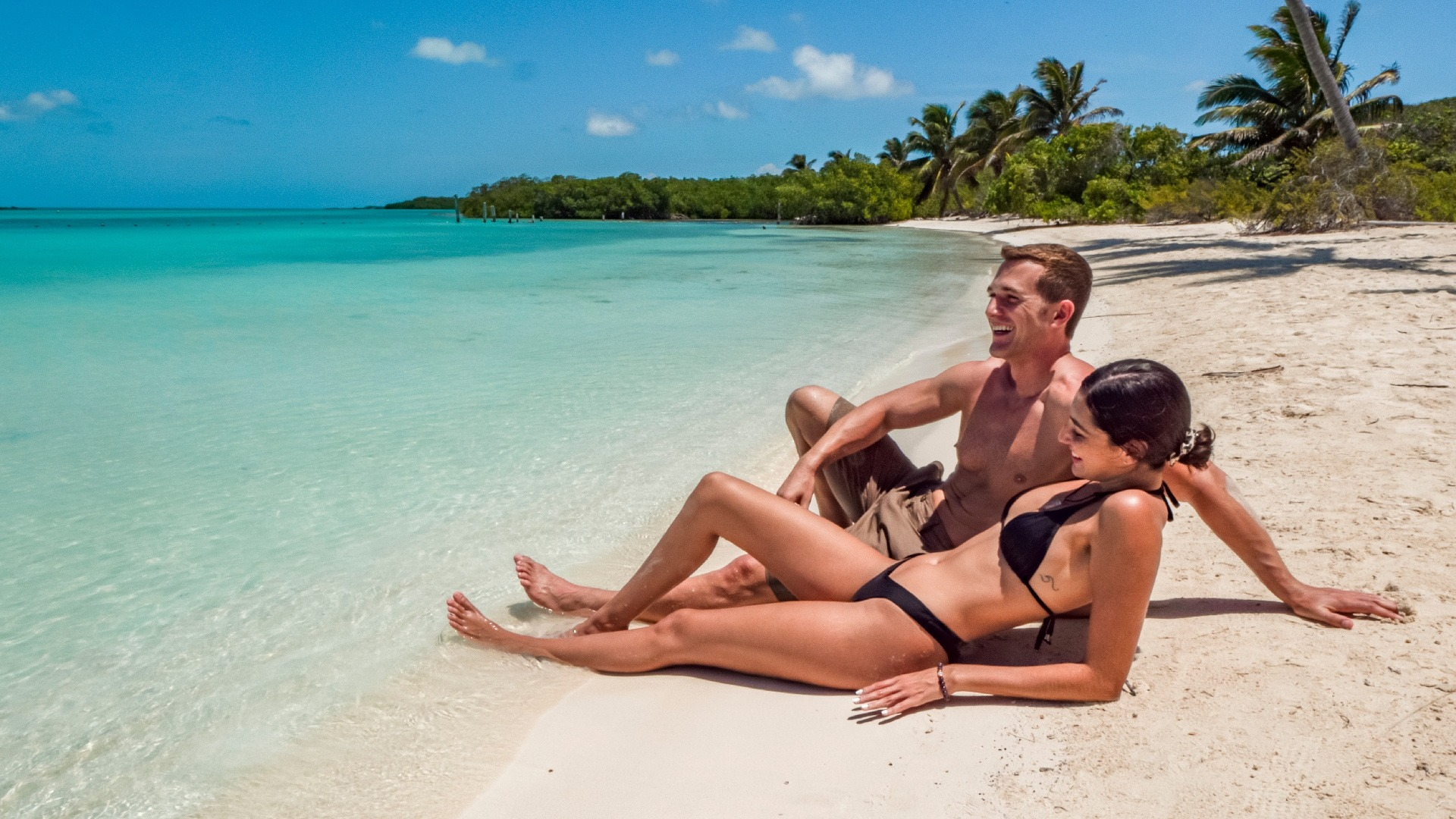 08 - LoRes - Isla Contoy Tour - Couple in beach